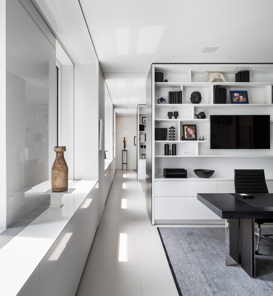 Inspiration for a contemporary freestanding desk white floor home office remodel in New York with white walls