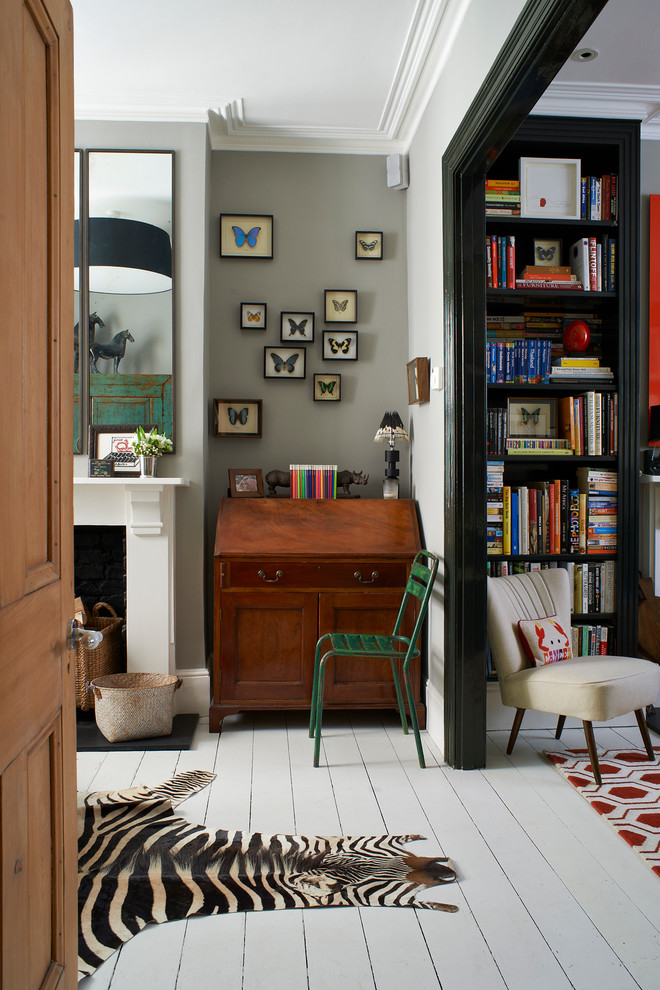 Example of an eclectic white floor home office design in London