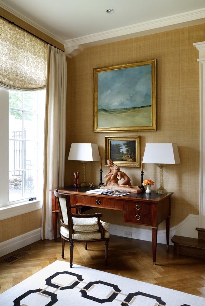 Elegant freestanding desk medium tone wood floor home office photo in DC Metro