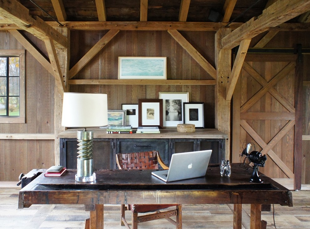 Inspiration for a mid-sized farmhouse freestanding desk light wood floor home office remodel in New York with brown walls