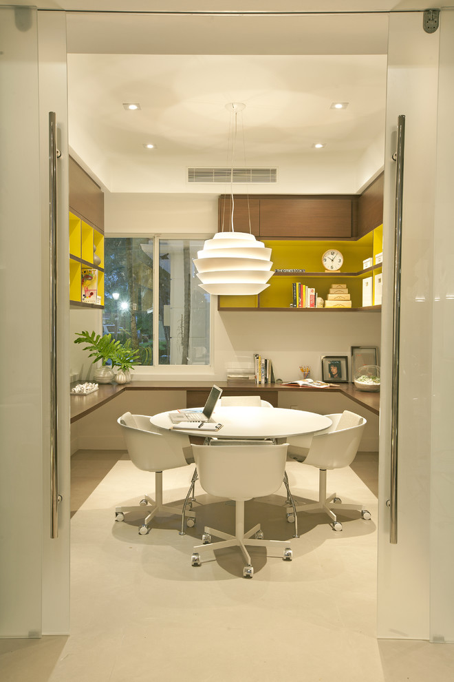 Home office - 1950s freestanding desk home office idea in Miami with white walls