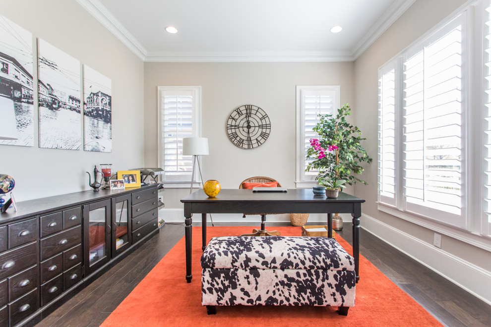 transitional home office with bright orange rug