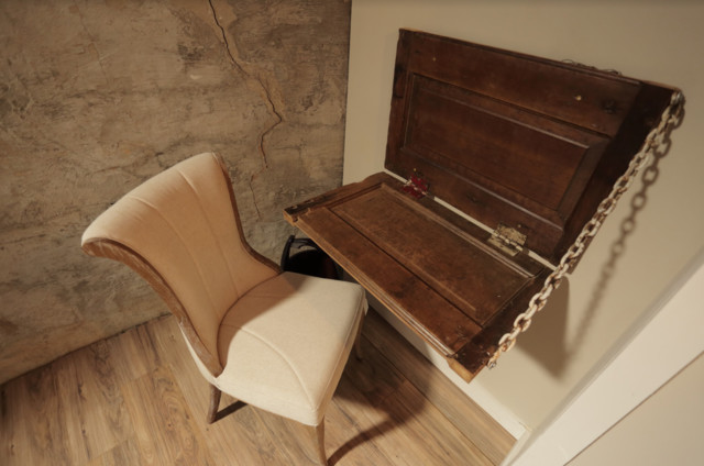 Home office - small country light wood floor home office idea in Other