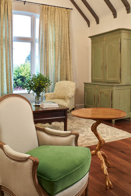 Green finishes add life and color to a neutral room.