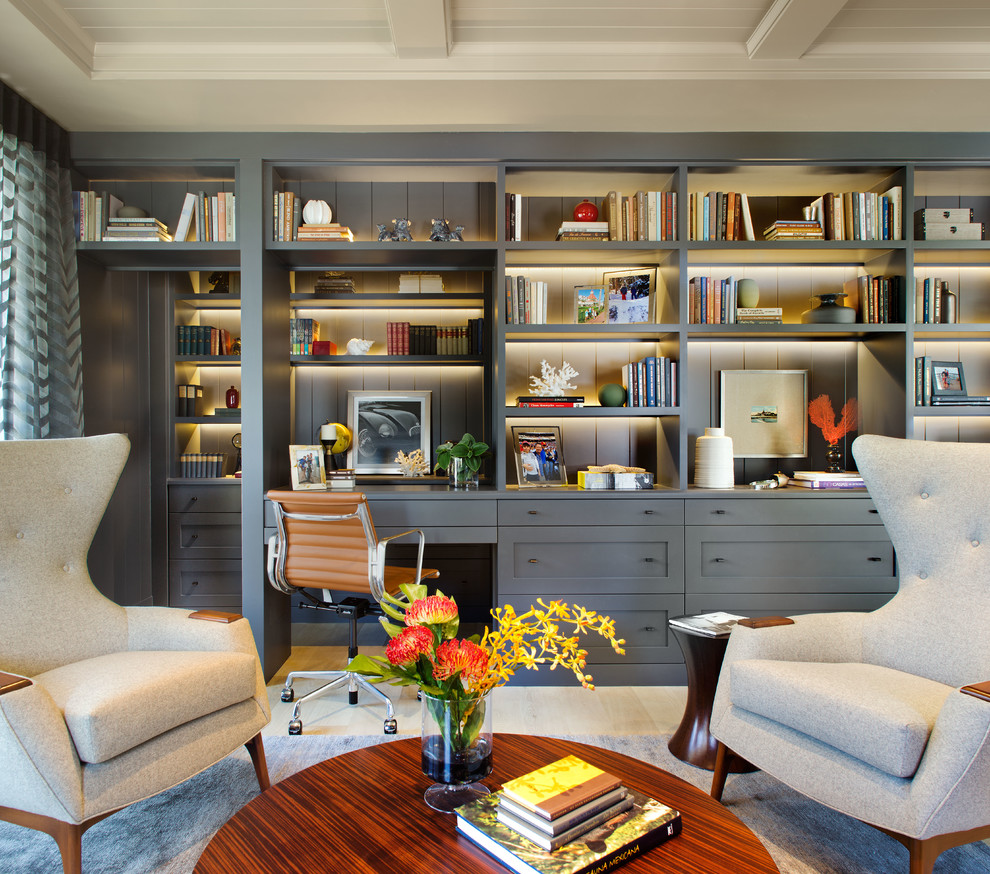 Study room - large transitional built-in desk light wood floor and beige floor study room idea in San Diego with no fireplace