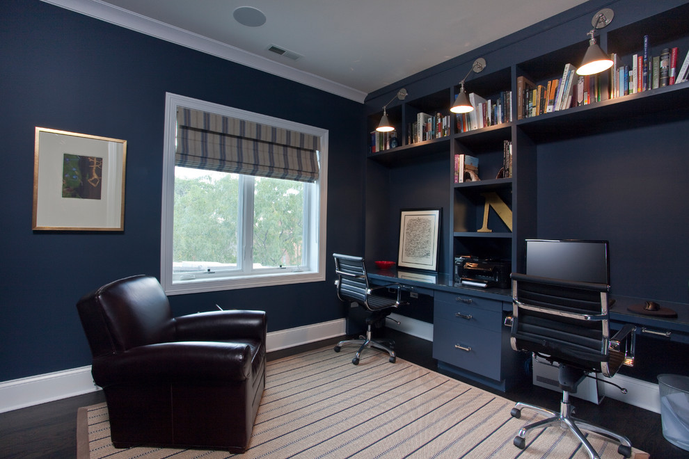 Trendy built-in desk home office photo in Chicago with blue walls
