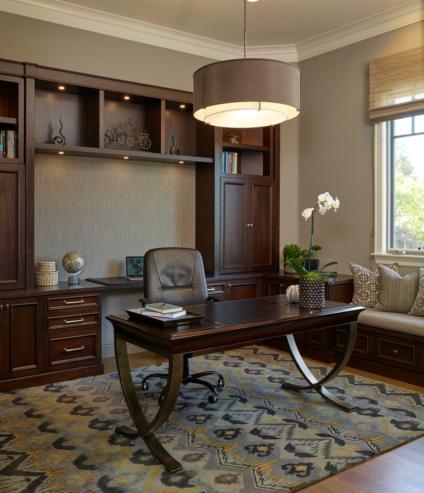 Mid-sized elegant freestanding desk medium tone wood floor study room photo in San Francisco with gray walls