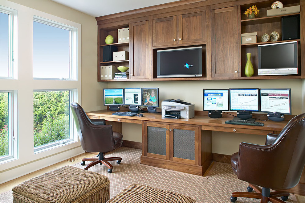 Home office - beach style built-in desk home office idea in New York