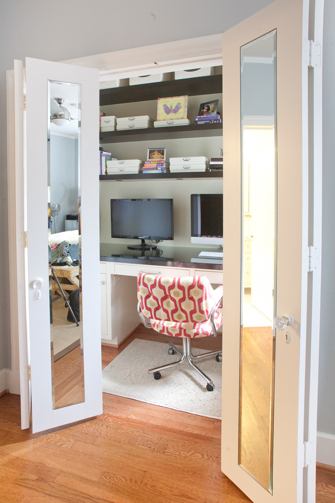 Example of a mid-sized trendy built-in desk medium tone wood floor and brown floor home office design in Dallas with beige walls and no fireplace