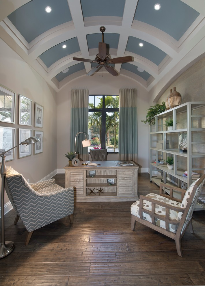Inspiration for a large mediterranean freestanding desk dark wood floor and brown floor study room remodel in Miami with gray walls