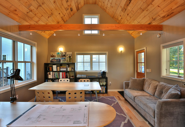 Example of a transitional freestanding desk medium tone wood floor home studio design in Portland Maine with gray walls