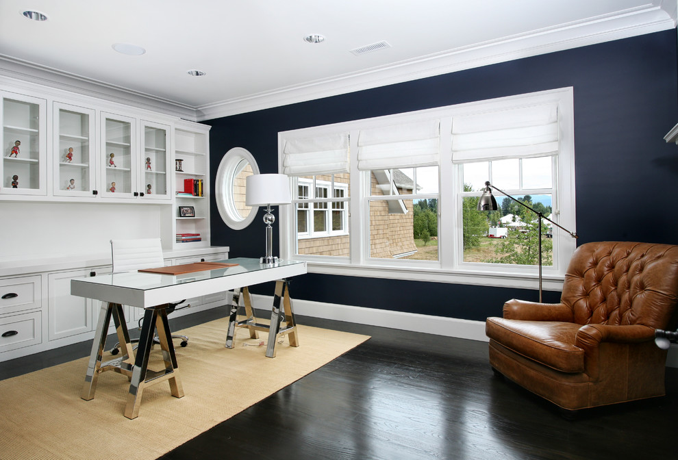 Home office - contemporary freestanding desk dark wood floor and black floor home office idea in Portland with blue walls