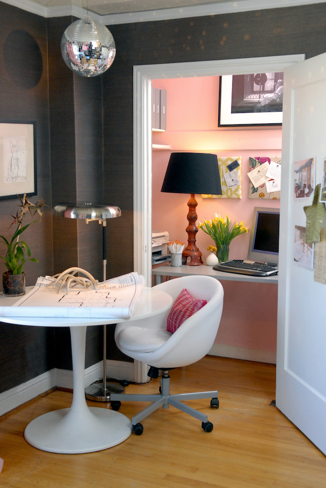 Inspiration for an eclectic home office remodel in San Francisco with pink walls