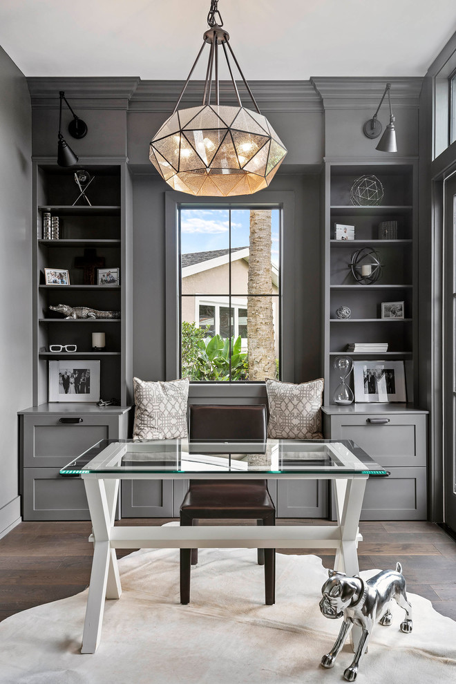 Example of a mid-sized transitional freestanding desk brown floor and dark wood floor study room design in Orlando with gray walls
