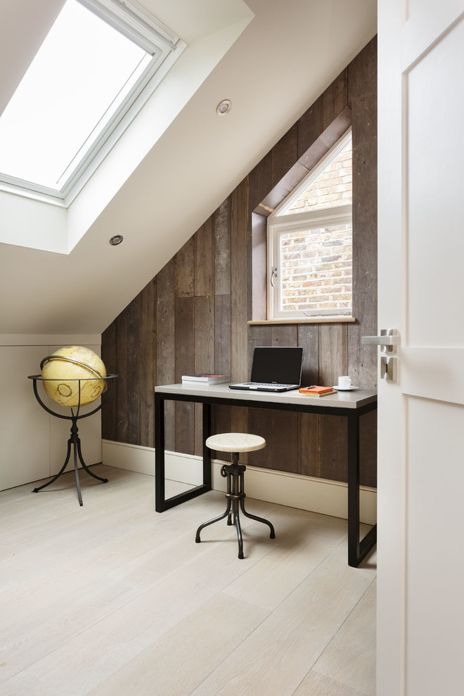 home office in attic with angled roof