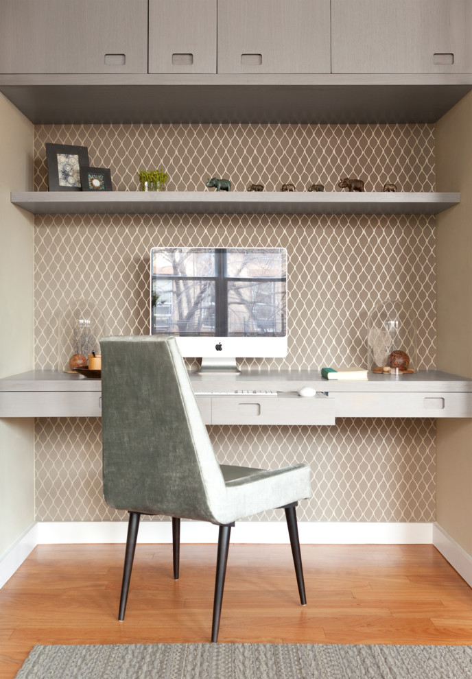 Home office - mid-sized contemporary built-in desk light wood floor home office idea in New York with no fireplace