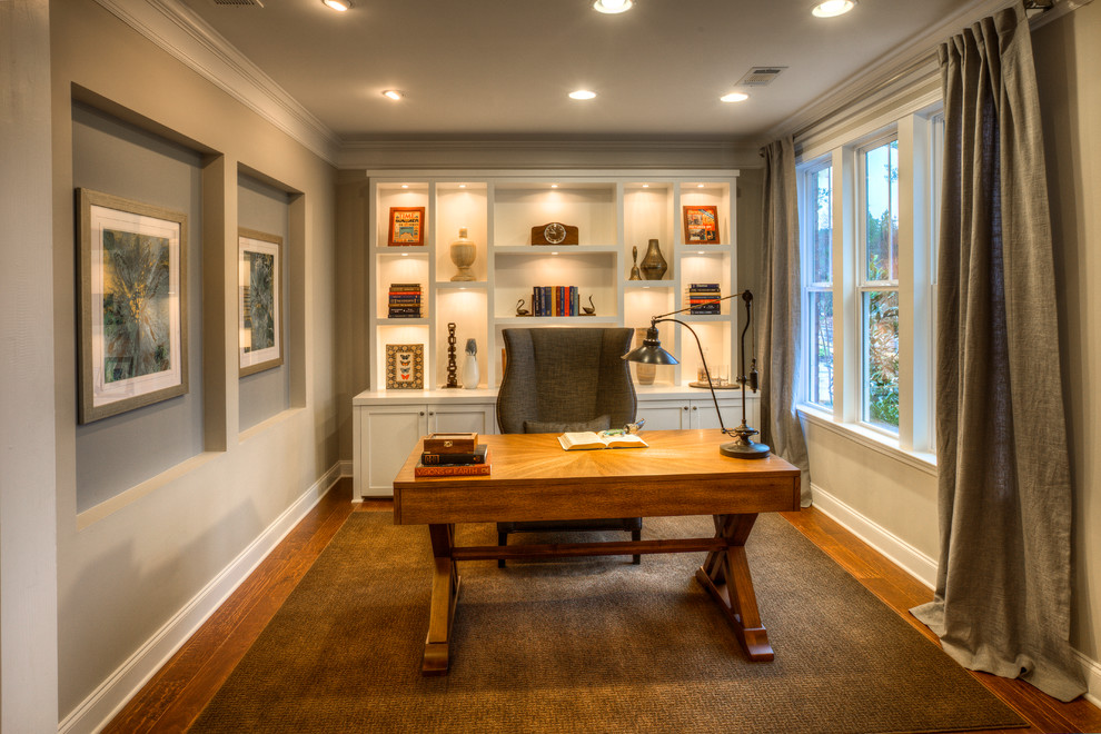 Example of a mid-sized transitional freestanding desk medium tone wood floor study room design in Atlanta with gray walls
