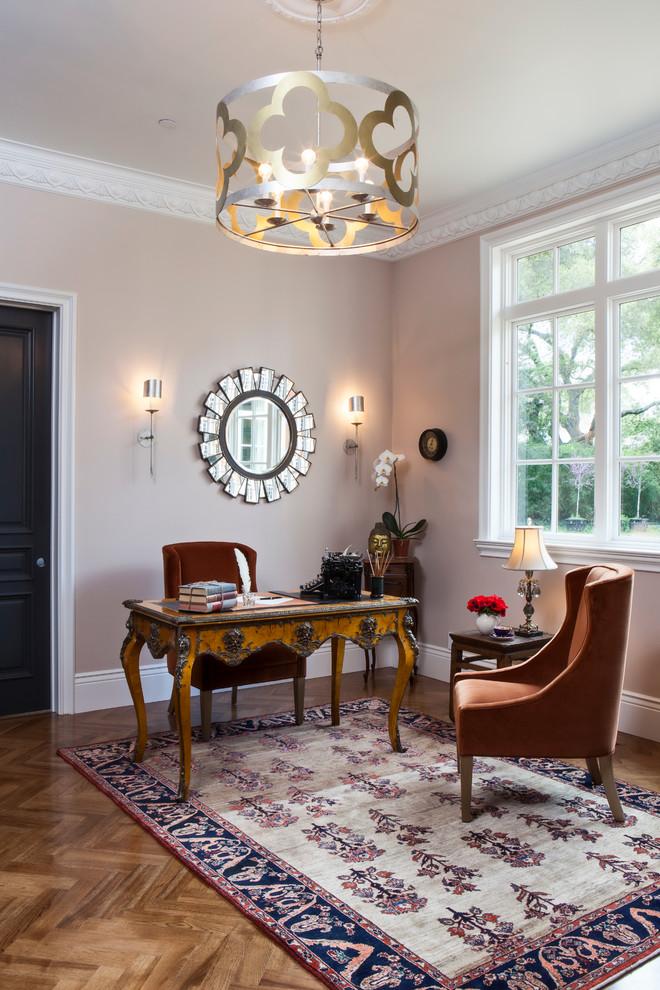 Mid-sized elegant freestanding desk medium tone wood floor study room photo in San Francisco with beige walls