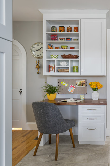 Example of a transitional built-in desk gray floor home office design in Boston with gray walls