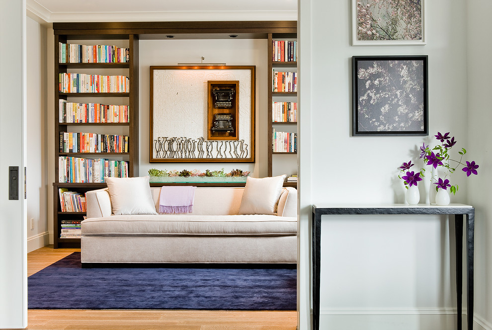 Transitional light wood floor home office photo in Boston with white walls