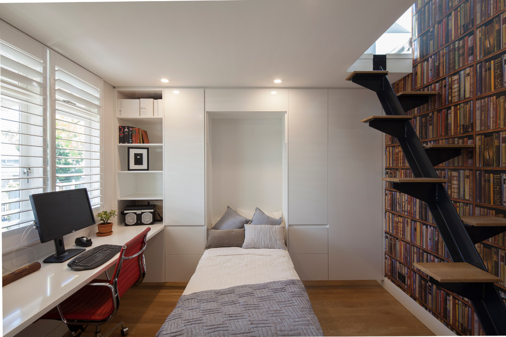 Small minimalist built-in desk medium tone wood floor home office photo in Sydney with white walls and no fireplace