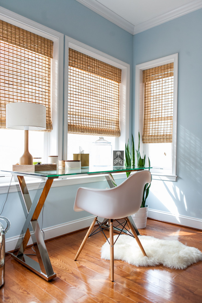 Home office - mid-sized transitional freestanding desk brown floor home office idea in Baltimore with blue walls