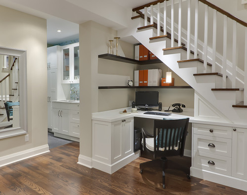 Home Office design with cabinetry under the stairs.