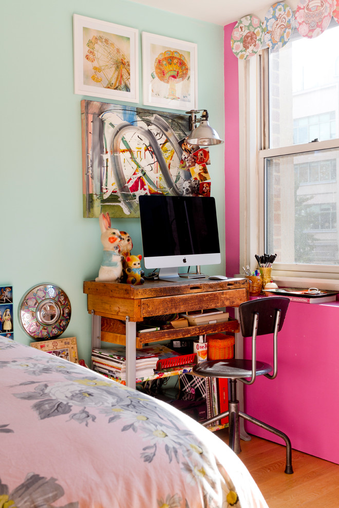 Inspiration for a small eclectic freestanding desk medium tone wood floor home office remodel in New York with multicolored walls