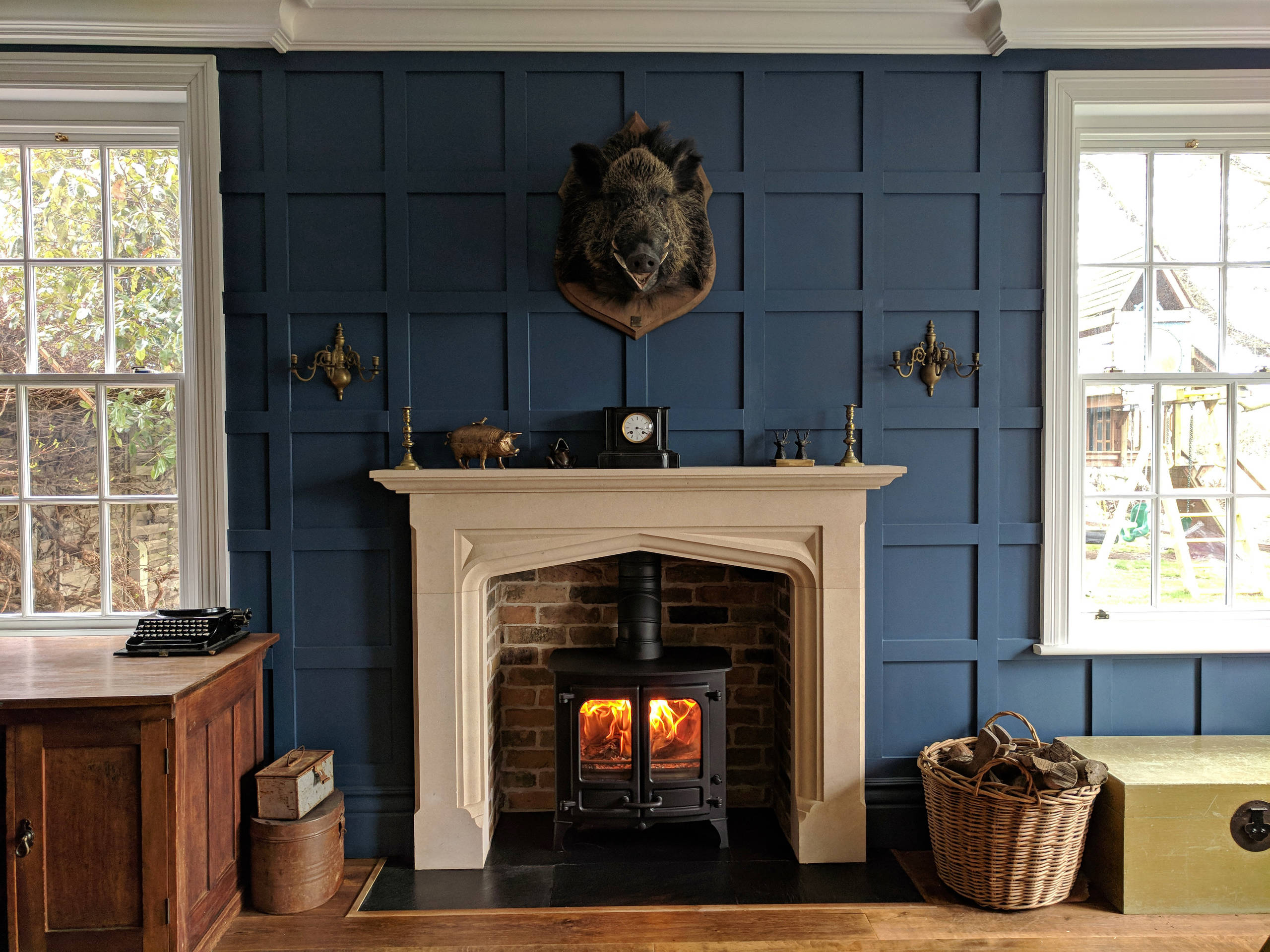 Bespoke limestone fireplace mantel in a traditional library ...
