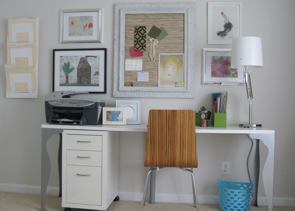Cottage chic freestanding desk carpeted home office photo in Philadelphia with white walls