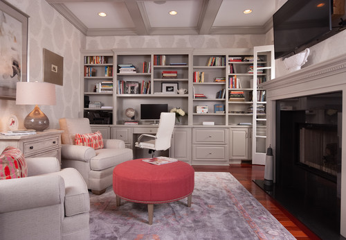 A family room with book shelves to hold tons of books.