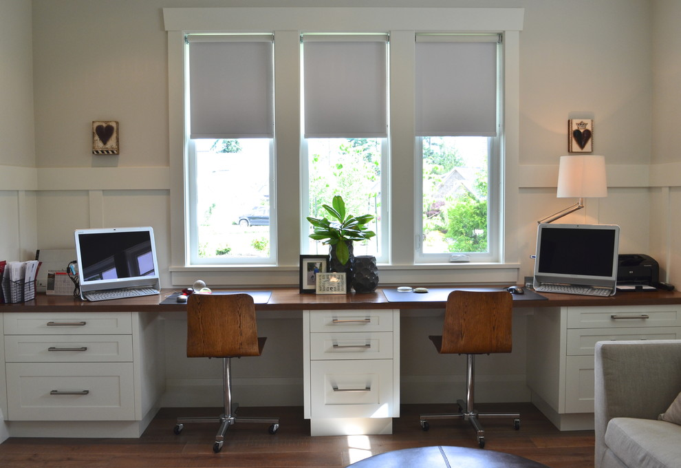 Example of a transitional built-in desk home office design in Vancouver