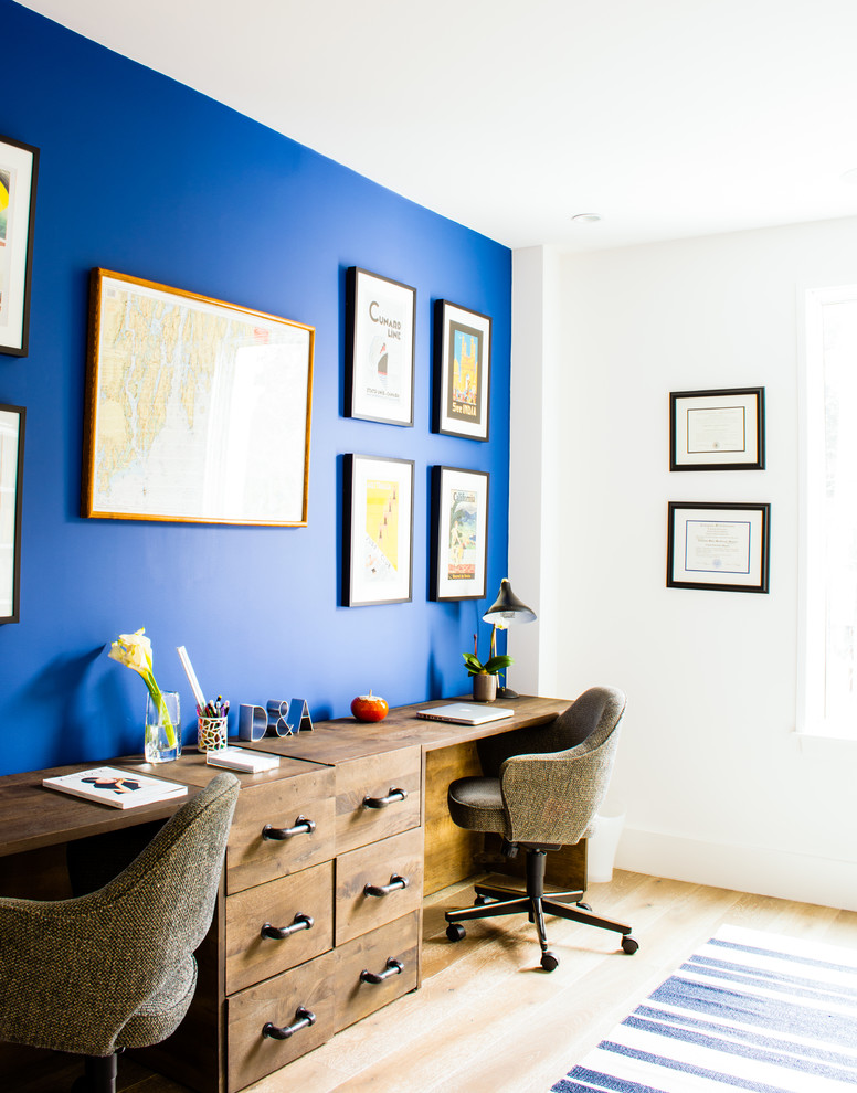 Example of a mid-sized transitional freestanding desk light wood floor study room design in Los Angeles with blue walls