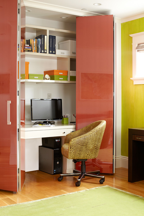A home office design hidden in a closet. In inspirational with built-in desk cabinetry.