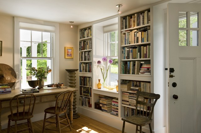 Bookcases flanking window traditional living room