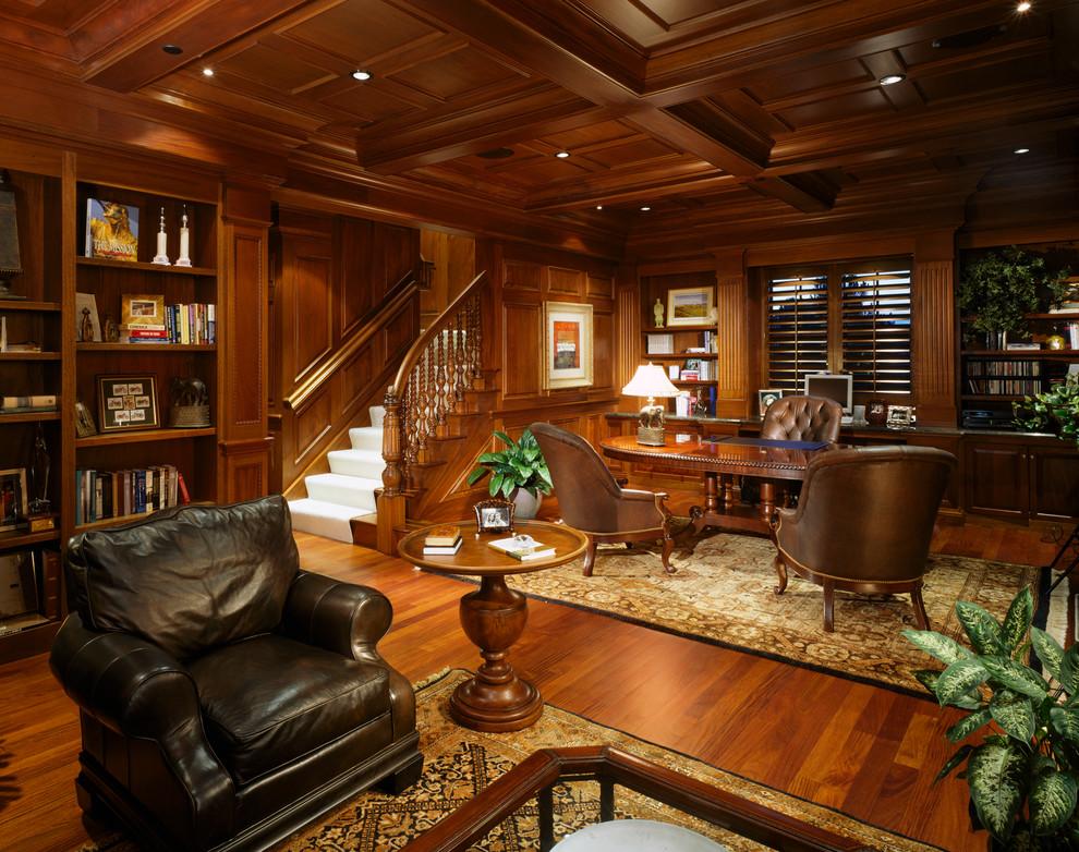 Inspiration for a huge timeless freestanding desk dark wood floor home office remodel in Denver