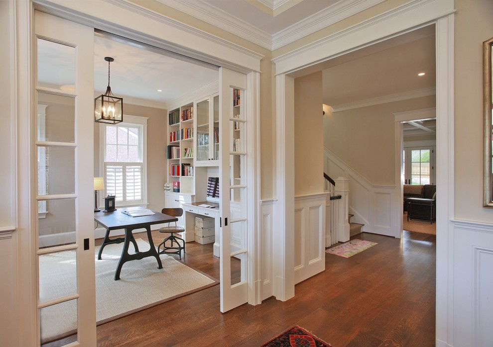 Home office - traditional freestanding desk medium tone wood floor home office idea in DC Metro with beige walls
