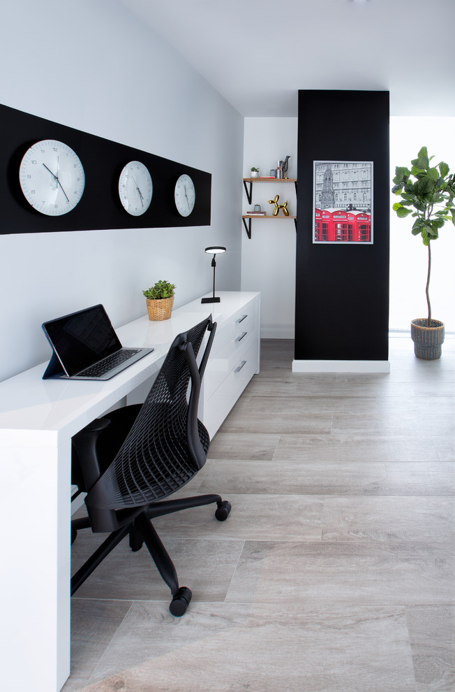 Example of a small danish freestanding desk vinyl floor home studio design in Miami with gray walls and no fireplace