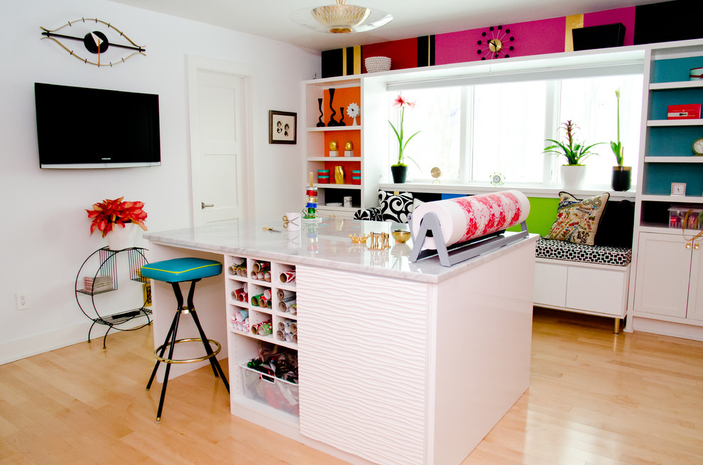 Inspiration for a contemporary craft room remodel in Cincinnati with white walls