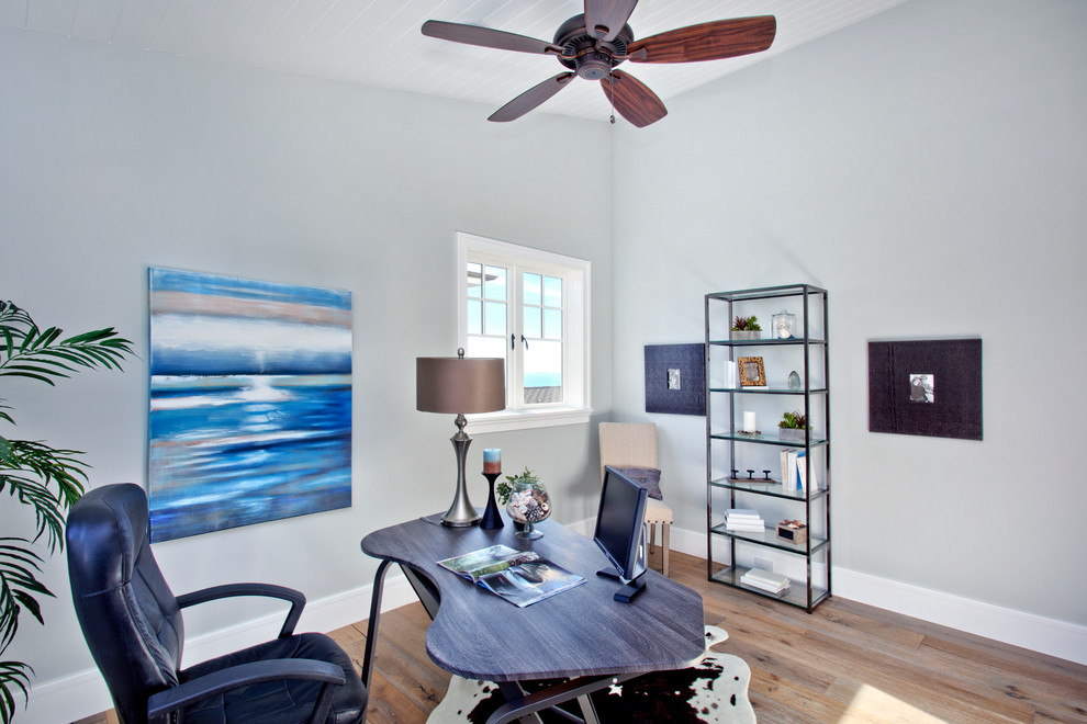 beach style home office with custom blue desk