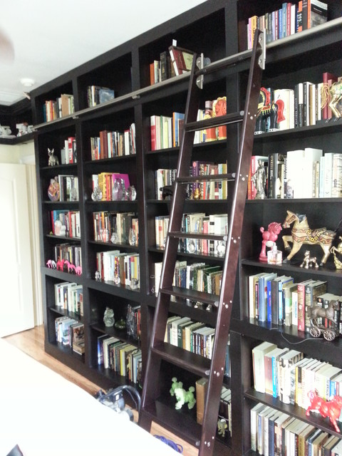 Built In Bookcases With Rolling Ladder And Hidden Vault
