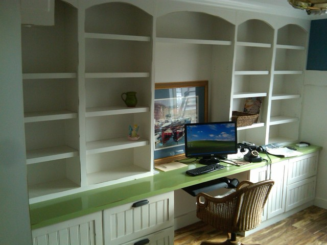 Built in shelving and cabinets. traditional home office