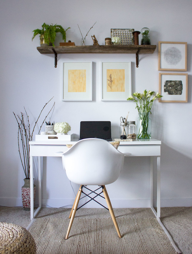Example of a small minimalist freestanding desk carpeted home office design in Toronto with white walls