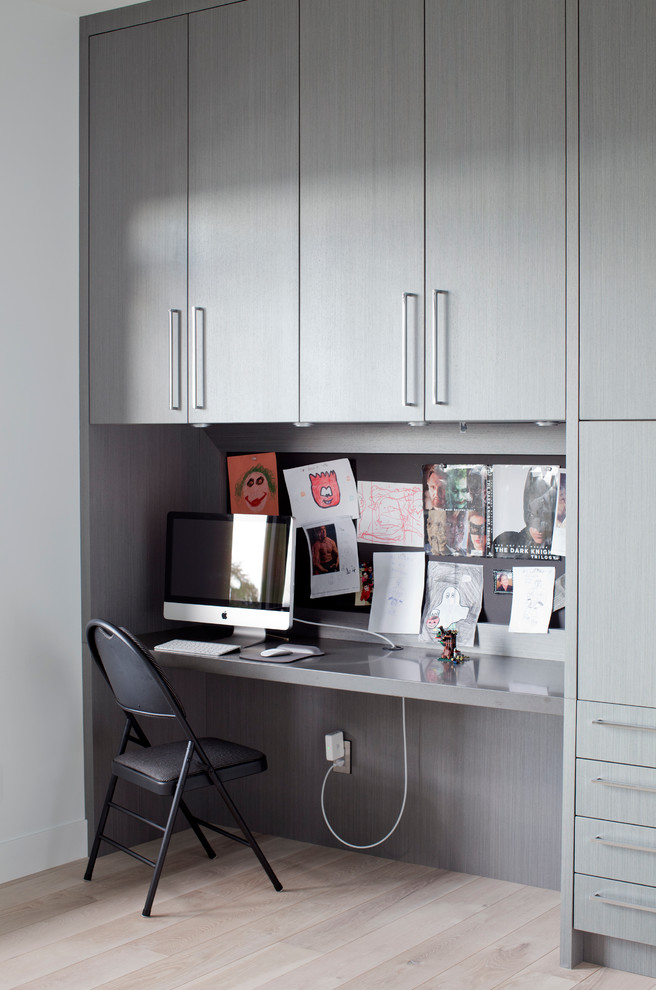 Trendy built-in desk home office photo in Vancouver