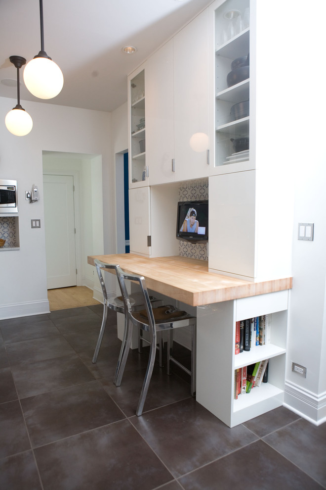Study room - small contemporary built-in desk ceramic floor and gray floor study room idea in Chicago with white walls