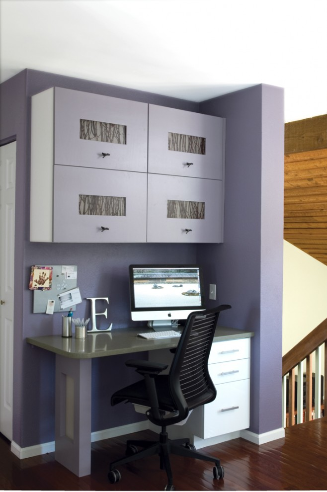 Inspiration for a contemporary home office remodel in Denver with purple walls