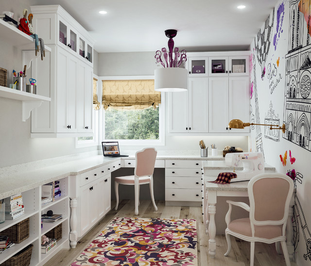 Example of a transitional built-in desk light wood floor craft room design in Sacramento with multicolored walls and no fireplace