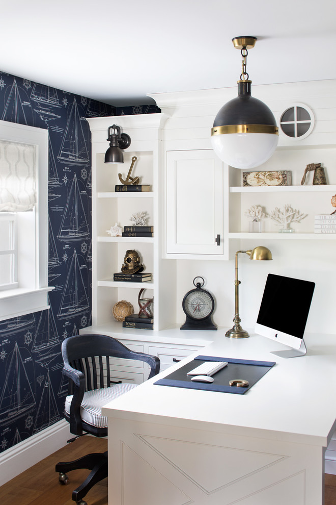 Example of a small beach style built-in desk medium tone wood floor and brown floor home office design in Miami with blue walls and no fireplace