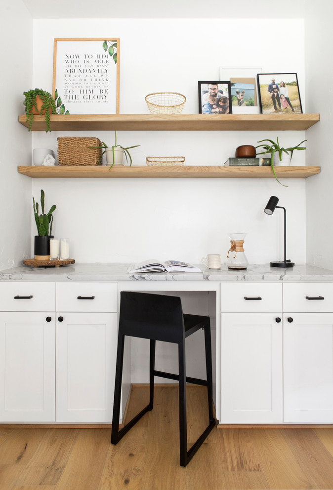 Study room - small scandinavian built-in desk light wood floor and beige floor study room idea in Dallas with white walls and no fireplace