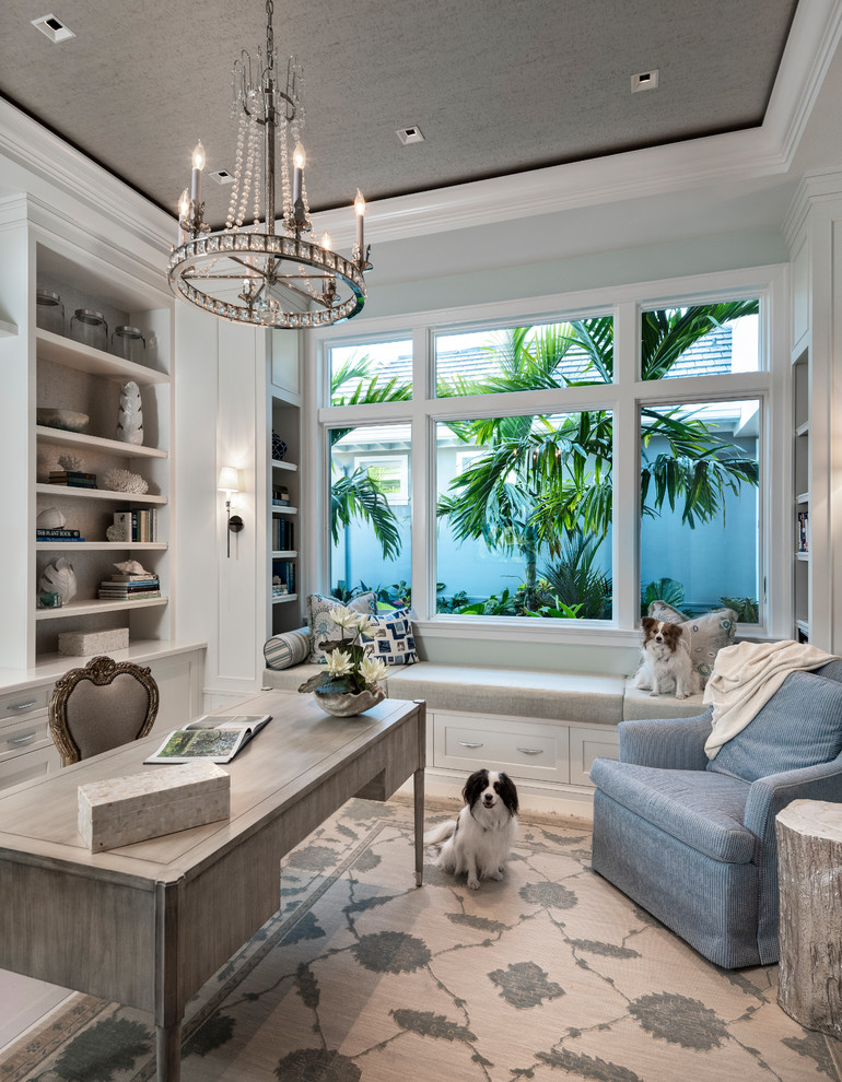 Transitional freestanding desk home office photo in Miami with gray walls